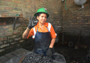 A member of the first all-female mining team at Coscuez shows off an emerald.