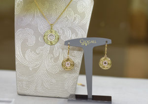 Clogau yellow gold, rose gold and white topaz Meander necklace and earrings