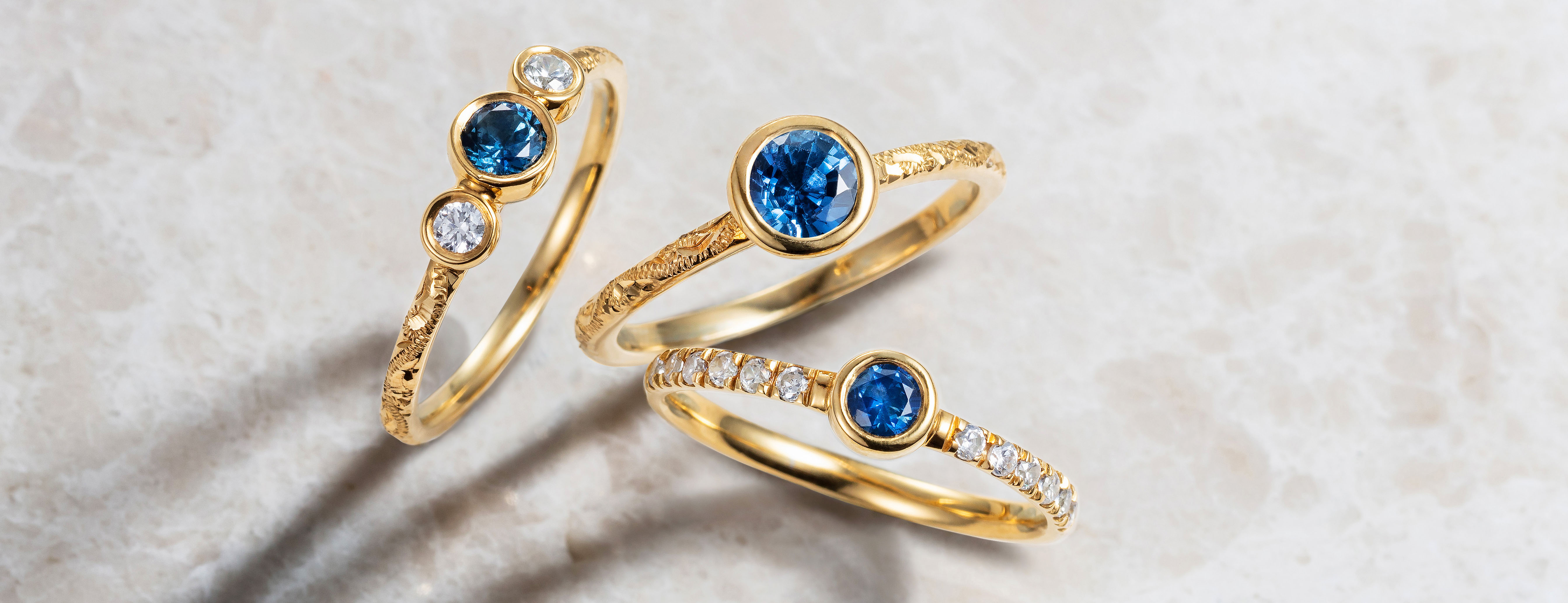 Arabel Lebrusan ethically sourced yellow gold, Canadian diamond and Malawi sapphire Hera engagement rings