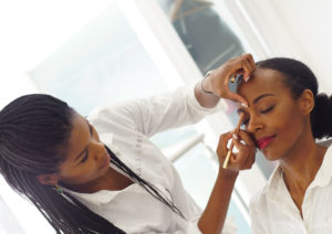 Nails & Brows Mayfair founder Sherrille Riley at work perfecting brows
