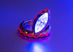The marquise-cut diamond and ruby Disco ring by Cora Sheibani glows under UV lights