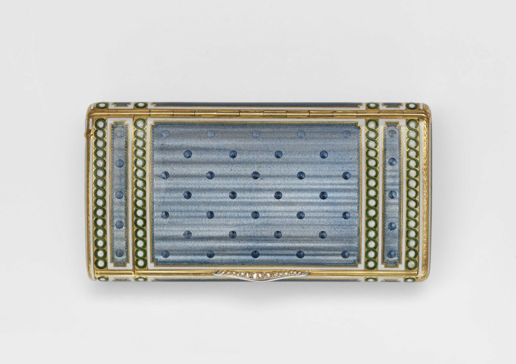 Gold and enamel engine-turned cigarette case with diamond thumbpiece, made by Cartier in 1907, part of the Kashmira Bulsara collection at the V&A Museum