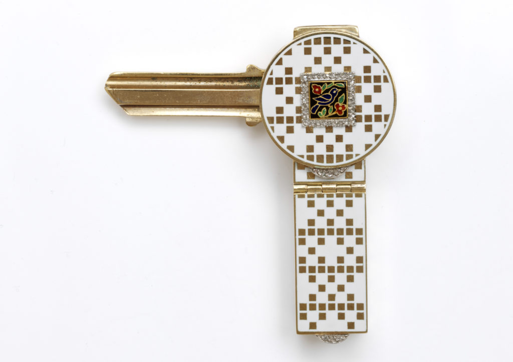 Gold and white enamel vanity case containing gold key, made by Cartier in 1925, part of the Kashmira Bulsara collection at the V&A Museum