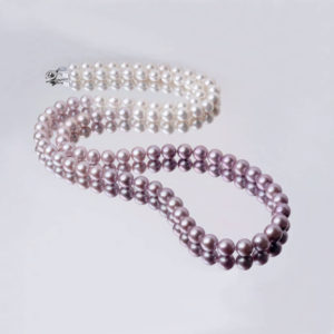 Remay London string of white and purple pearls