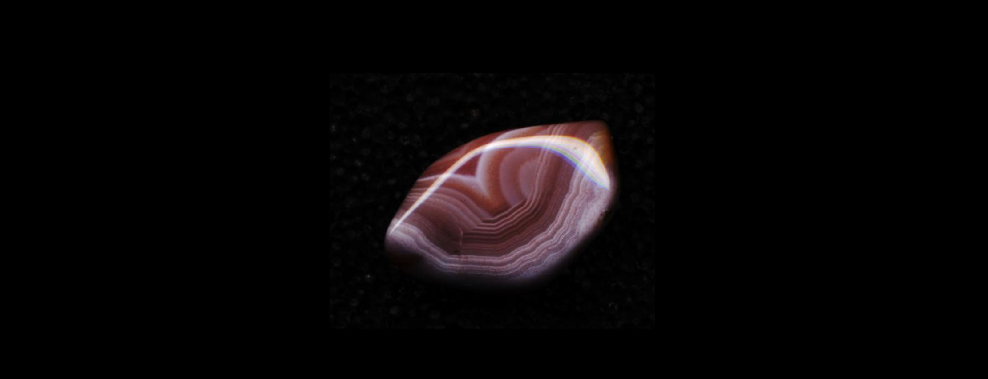 A smooth cut of reddish Armenian agate