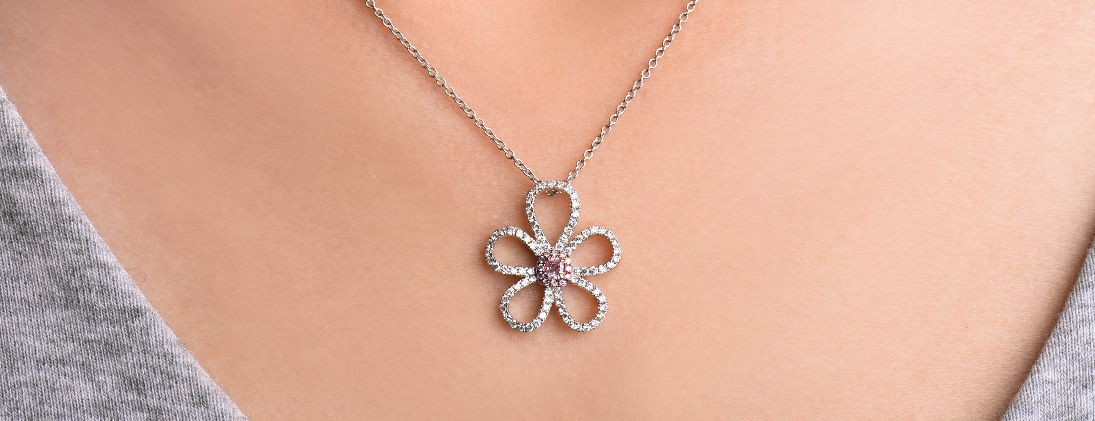 Astteria white and rose gold floral neckllace set with white and pink diamonds