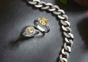 Yellow diamond rings and chunky white gold chain by Aria Designs