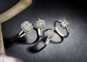 A collection of Aria Designs diamond rings that use gemstone marquetry to create big-diamond looks