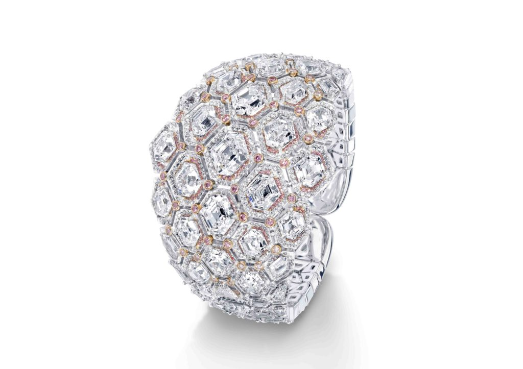 David Morris Hexagon cuff, crafted with 69.79ct brilliant, fancy and triangle cut white and pink diamonds