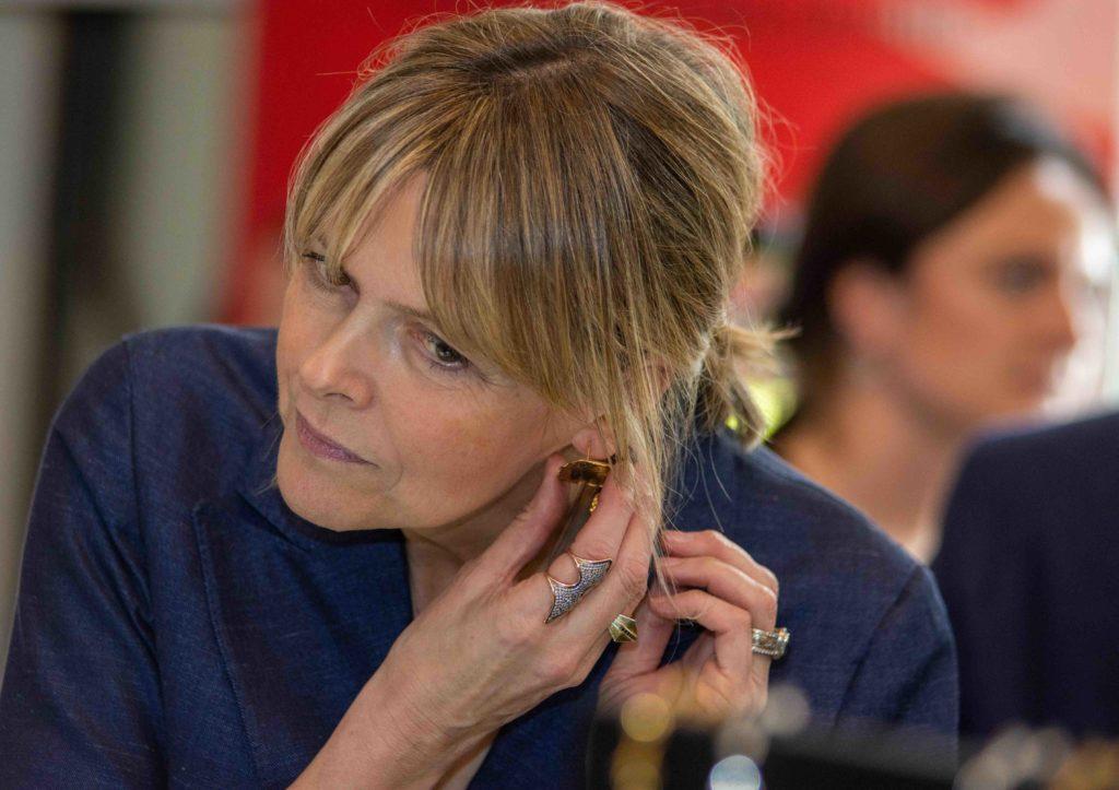 Vogue's Carol Woolton trying on a pair of Deborah Blyth earrings
