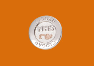 Clogau has created a silver pin badge to raise funds for the NHS