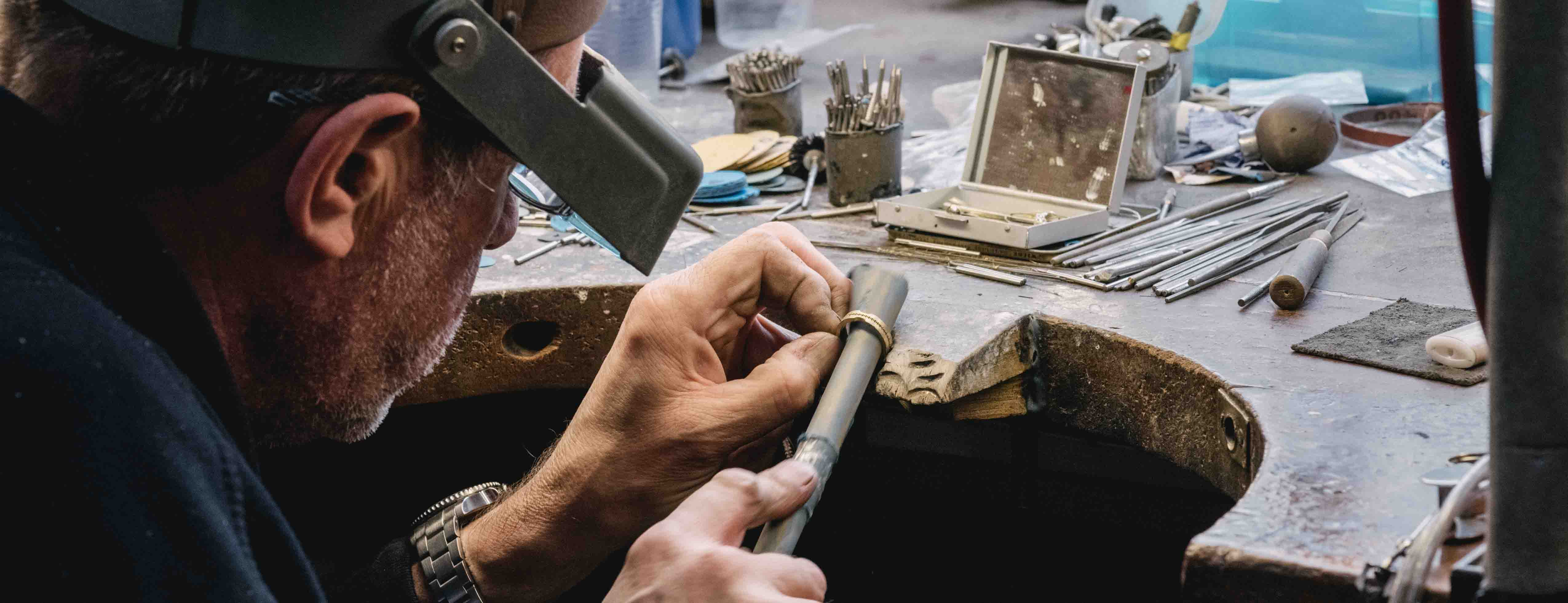 A goldsmith works on a ring at the Hockley Mint workshop in Birmingham
