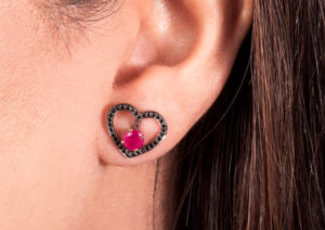 Alice van Cal rhodium-plated 18ct gold and black diamod halo shown with a ruby stud