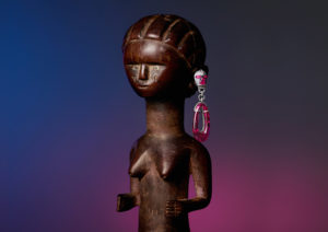 Satta Matturi earrings hot on an African wooden sculpture, by Isabelle Bonjean for The Economist