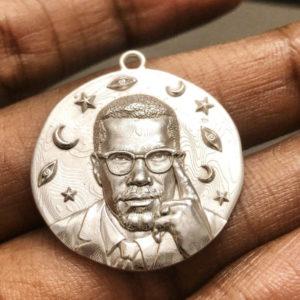 Sewit Sium silver Malcom X medallion