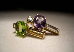 Rossella Ugolini gold earrings set with peridot and amethyst