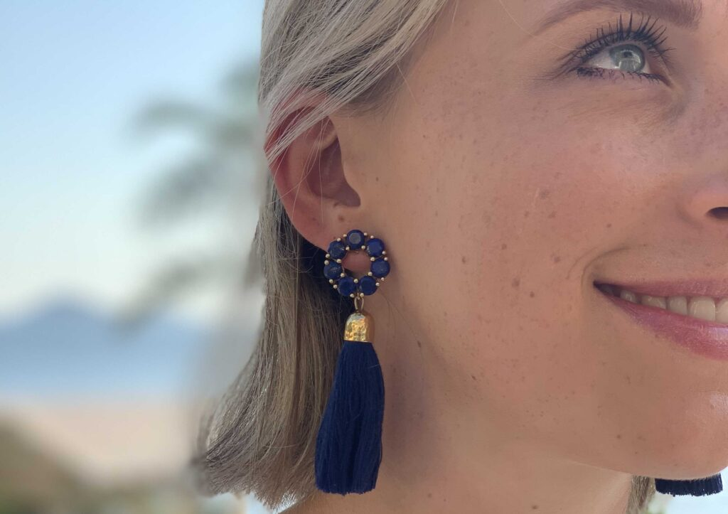 Threads Styling Harriet Hedges wearing Coco & Kinney earrings