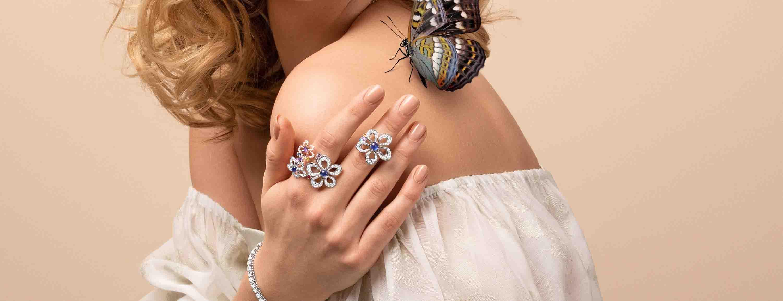 Gubelin flower diamond rings