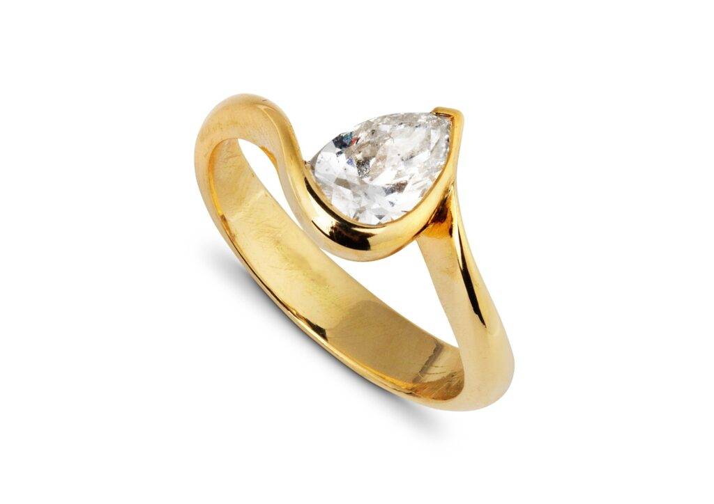 Jessie Thomas gold and pear-cut diamond engagement ring